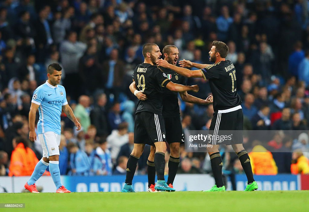 Gianluigi Buffon, Andrea Barzagli of Juventus celebrate victory as Sergio Aguero of Manchester City looks dejected after the UEFA Champions League Group D match between Manchester City FC and Juventus at the Etihad Stadium on September 15, 2015 in Manchester, United Kingdom.