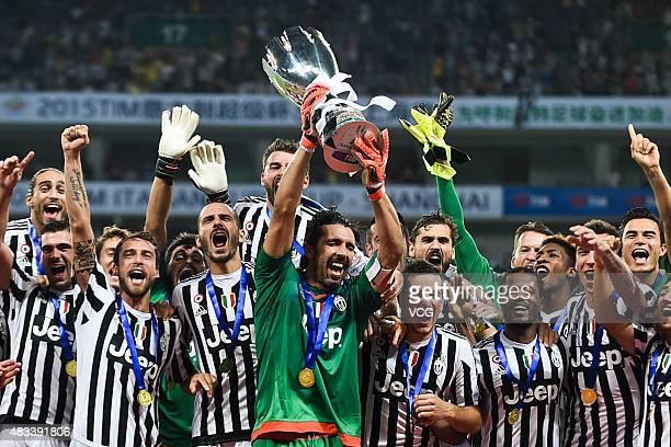 Gianluigi Buffon captain of Juventus FC celebrates with teammates after winning SS Lazio during Italian Super Cup final football match between...