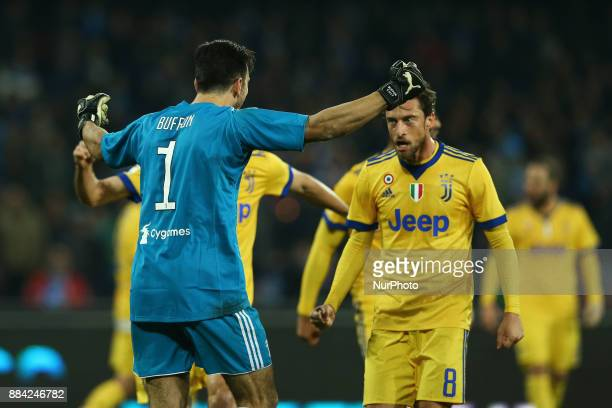 Gianluigi Buffon celebrating with Claudio Marchisio of Juventus during the Serie A match between SSC Napoli and Juventus at Stadio San Paolo on...