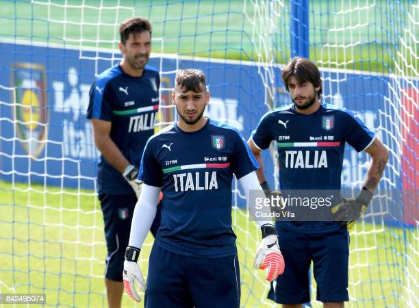 Gianluigi Buffon Gianluigi Donnarumma and Mattia Perin of Italy look on during the training session at Italy club's training ground at Coverciano on...