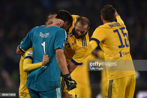 Gianluigi Buffon Giorgio Chiellini and Andrea Barzagli of Juventus celebrate after winning the Serie A match between SSC Napoli and Juventus at...