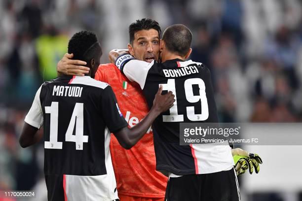 Gianluigi Buffon goalkeeper of Juventus celebrates the victory with teammates Blaise Matuidi and Leonardo Bonucci during the Serie A match between...
