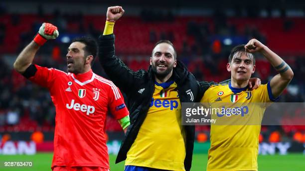Gianluigi Buffon Gonzalo Higuain and Paulo Dybala of Juventus celebrate at the end of the UEFA Champions League Round of 16 Second Leg match between...