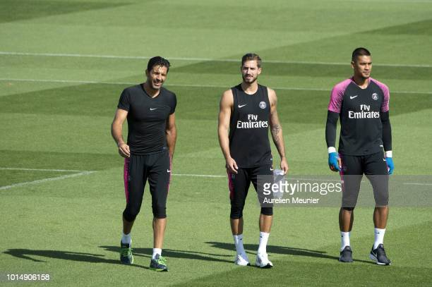 Gianluigi Buffon Kevin Trapp and Alphonse Areola react during a Paris SaintGermain training session at Ooredoo Center on August 11 2018 in Paris...