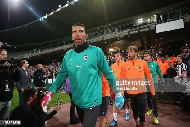 Gianluigi Buffon leads the Juventus players onto the pitch during a Juventus training session at WIN Jubilee Stadium on August 9 2014 in Sydney...