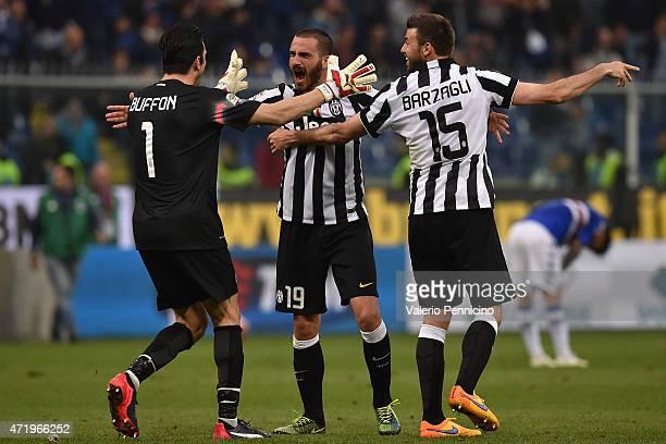 Gianluigi Buffon Leonardo Bonucci and Andrea Barzagli of Juventus FC celebrate after beating UC Sampdoria 10 to win the Serie A Championships at the...
