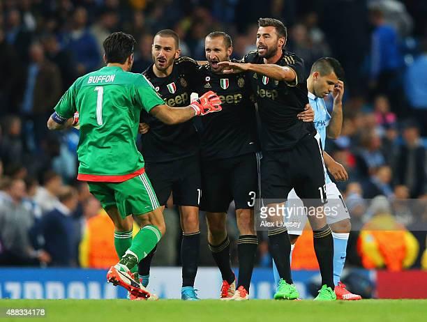 Gianluigi Buffon, Leonardo Bonucci, Giorgio Chiellini and Andrea Barzagli of Juventus celebrate victory as Sergio Aguero of Manchester City look...
