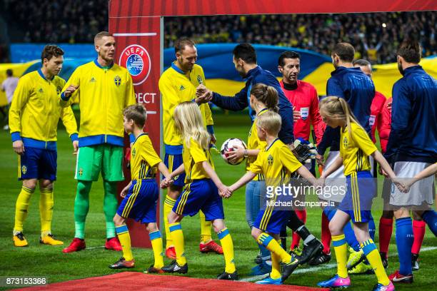Gianluigi Buffon of Buffon shakes hans with Andreas Granqvist of Sweden during the FIFA 2018 World Cup Qualifier PlayOff First Leg between Sweden and...