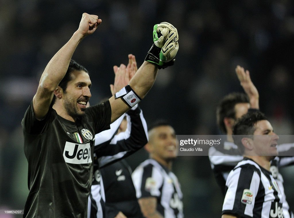 Gianluigi Buffon of FC Juventus (L) celebrates victory after the Serie A match between Cagliari Calcio and FC Juventus at Stadio Ennio Tardini on December 21, 2012 in Parma, Italy.
