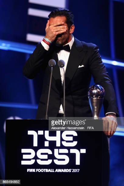 Gianluigi Buffon of Italy and Juventus accepts the Best Goalkeeper Award during The Best FIFA Football Awards at The London Palladium on October 23...