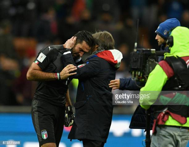 Gianluigi Buffon of Italy and Team manager Italy Gabriele Oriali dejected at the end of the FIFA 2018 World Cup Qualifier PlayOff Second Leg between...