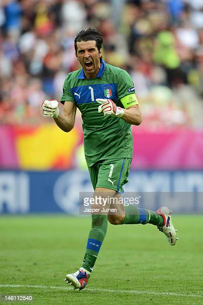 Gianluigi Buffon of Italy celebrates after Italy scored during the UEFA EURO 2012 group C match between Spain and Italy at The Municipal Stadium on...