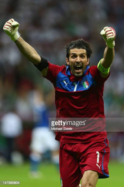 Gianluigi Buffon of Italy celebrates after team-mate Mario Balotelli scored his team's second goal during the UEFA EURO 2012 semi final match between...