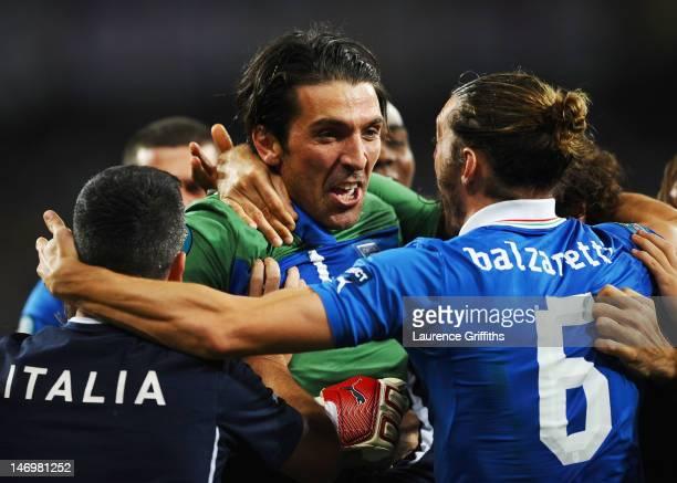 Gianluigi Buffon of Italy celebrates with Federico Balzaretti of Italy and team-mates during the UEFA EURO 2012 quarter final match between England...