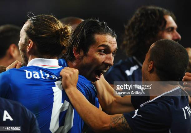 Gianluigi Buffon of Italy celebrates with team-mates after the penalty shoot out during the UEFA EURO 2012 quarter final match between England and...