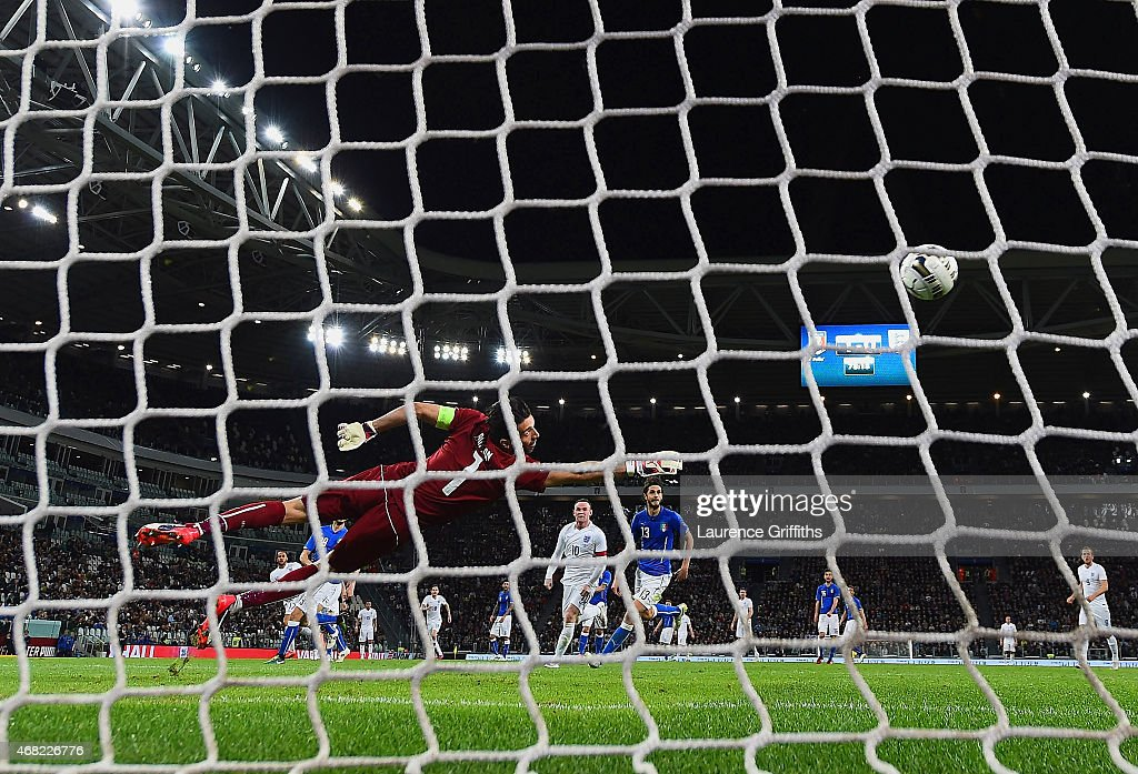Gianluigi Buffon of Italy dives in vain as Andros Townsend of England scores their first goal during the international friendly match between Italy and England at the Juventus Arena on March 31, 2015 in Turin, Italy.