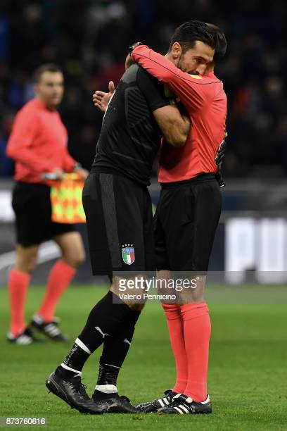 Gianluigi Buffon of Italy embraces Antonio Mateu Lahoz referee during the FIFA 2018 World Cup Qualifier PlayOff Second Leg between Italy and Sweden...