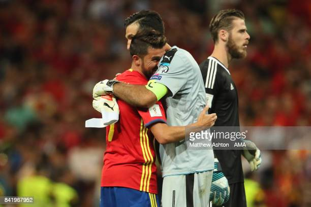 Gianluigi Buffon of Italy embraces David Villa of Spain at the end of the FIFA 2018 World Cup Qualifier between Spain and Italy at Estadio Santiago...