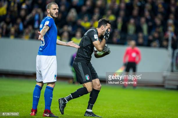 Gianluigi Buffon of Italy holds his mouth after colliding with teammate Giorgio Chiellini during the FIFA 2018 World Cup Qualifier PlayOff First Leg...