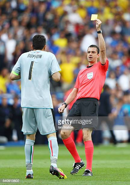 Gianluigi Buffon of Italy is shown a yellow card from referee Victor Kassai for time wasting during the UEFA EURO 2016 Group E match between Italy...