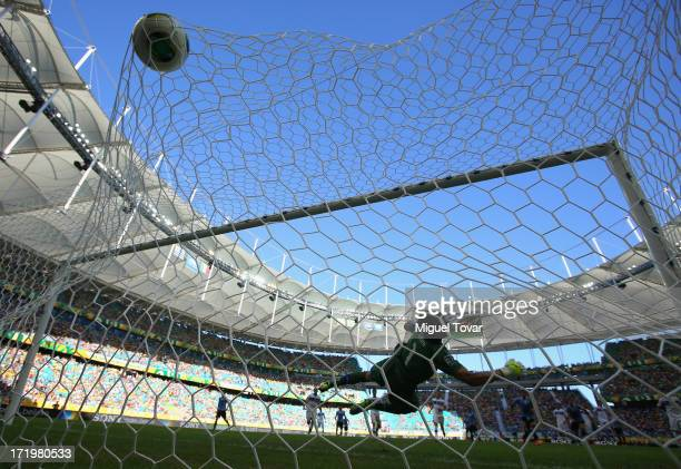 Gianluigi Buffon of Italy is unable to stop Edinson Cavani of Uruguay scoring his team's second goal during the FIFA Confederations Cup Brazil 2013...