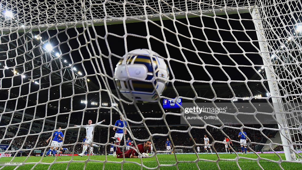 Gianluigi Buffon of Italy looks on as Wayne Rooney of England celebrates after Andros Townsend of England (not pictured) scored their first goal during the international friendly match between Italy and England at the Juventus Arena on March 31, 2015 in Turin, Italy.