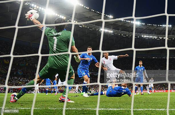 Gianluigi Buffon of Italy makes a save during the UEFA EURO 2012 quarter final match between England and Italy at The Olympic Stadium on June 24 2012...