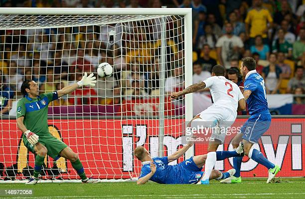 Gianluigi Buffon of Italy makes a save from Glen Johnson of England during the UEFA EURO 2012 quarter final match between England and Italy at The...
