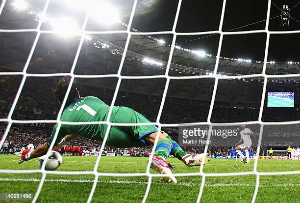 Gianluigi Buffon of Italy saves a penalty taken by Ashley Cole of England during the UEFA EURO 2012 quarter final match between England and Italy at...