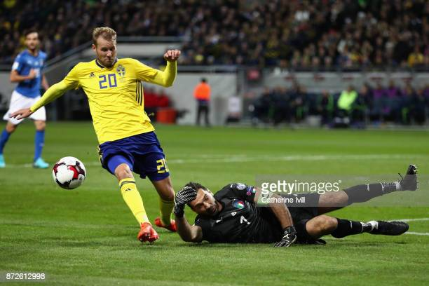 Gianluigi Buffon of Italy saves from Ola Toivonen of Sweden during the FIFA 2018 World Cup Qualifier PlayOff First Leg between Sweden and Italy at...