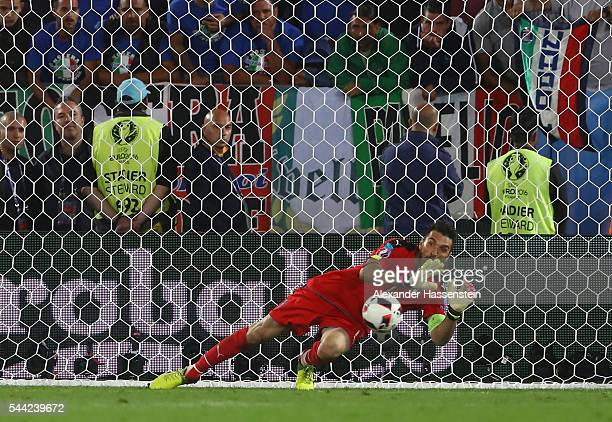 Gianluigi Buffon of Italy saves the penalty by Thomas Mueller of Germany at the penalty shootout during the UEFA EURO 2016 quarter final match...