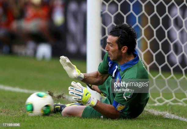 Gianluigi Buffon of Italy saves the penalty of Martin Caceres of Uruguay during a shootout during the FIFA Confederations Cup Brazil 2013 3rd Place...