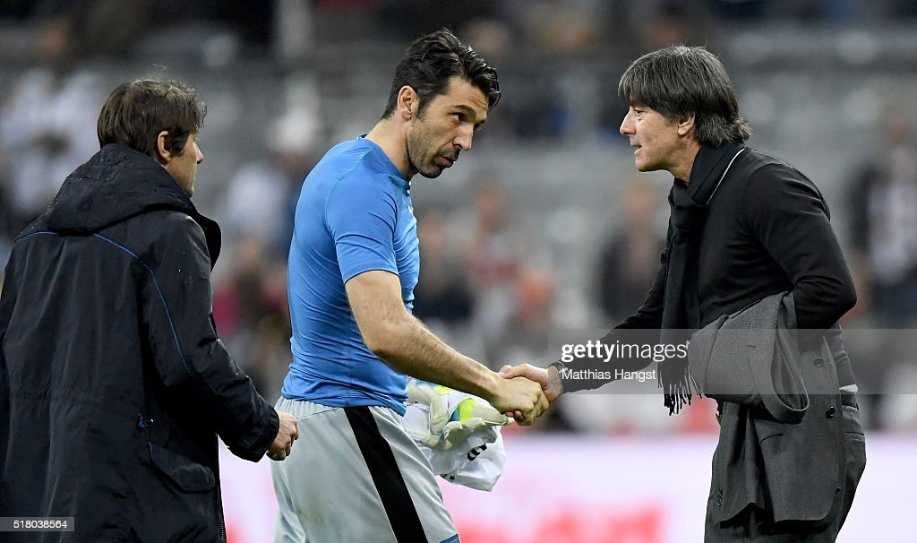 Gianluigi Buffon of Italy shakes hands with head coach Joachim Loew of Germany after the International Friendly match between Germany and Italy at Allianz Arena on March 29, 2016 in Munich, Germany.