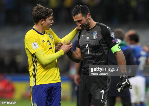 Gianluigi Buffon of Italy shakes hands with Victor Lindelof of Sweden at the end of the FIFA 2018 World Cup Qualifier PlayOff Second Leg between...