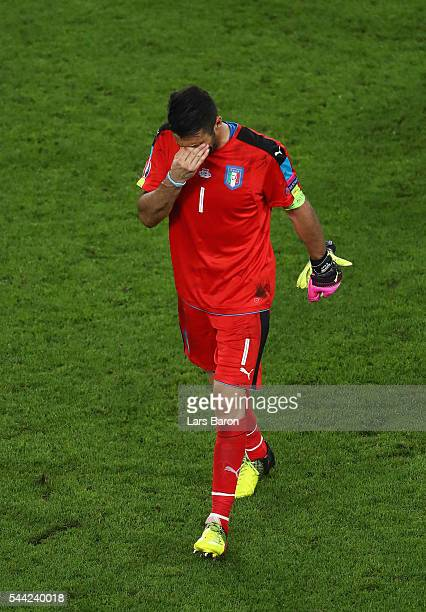 Gianluigi Buffon of Italy shows his dejeciton after his team's defeat through the penalty shootout during the UEFA EURO 2016 quarter final match...