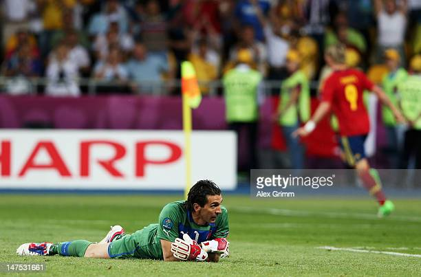 Gianluigi Buffon of Italy shows his dejection as he lies on the turf after conceding a goal scored by Fernando Torres during the UEFA EURO 2012 final...