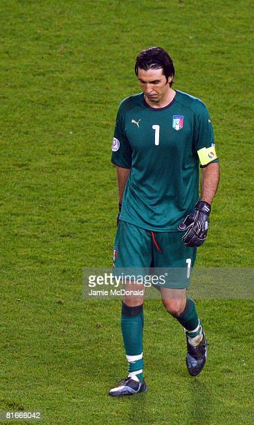 Gianluigi Buffon of Italy walks off after his team were defeated in the penalty shoot out during the UEFA EURO 2008 Quarter Final match between Spain...