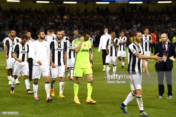Gianluigi Buffon of Juventus and his Juventus team mates are dejected after the UEFA Champions League Final between Juventus and Real Madrid at...