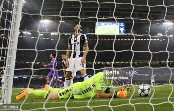 Gianluigi Buffon of Juventus and Leonardo Bonucci of Juventus react during the UEFA Champions League Final between Juventus and Real Madrid at...
