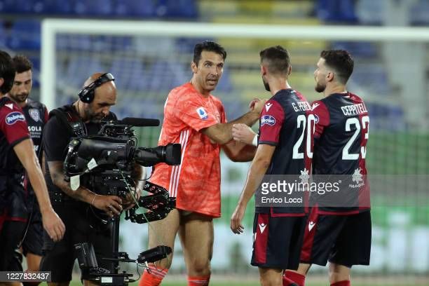 Gianluigi Buffon of Juventus and the players of Cagliari during the Serie A match between Cagliari Calcio and Juventus at Sardegna Arena on July 29,...