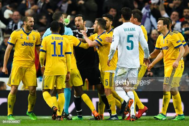 Gianluigi Buffon of Juventus argues with the referee Michael Oliver during the UEFA Champions League Quarter Final scond leg match between Real...
