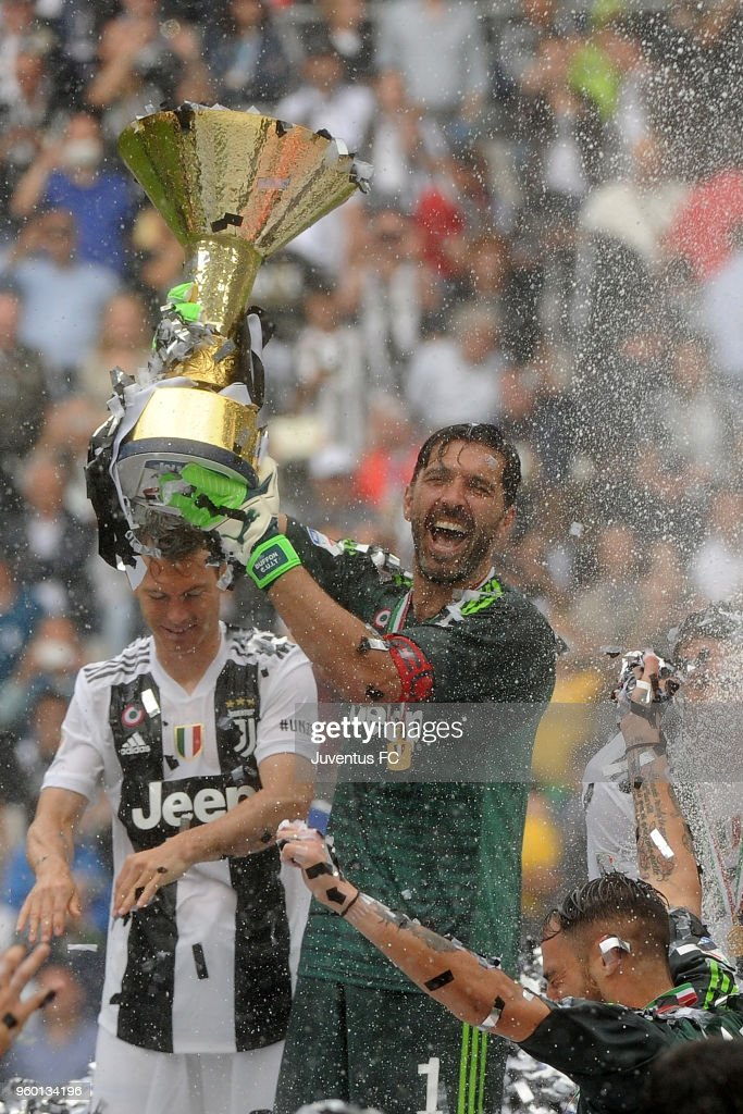 Gianluigi Buffon of Juventus celebrating with the trophy the seventh league titles in a row after the serie A match between Juventus and Hellas Verona FC at Allianz Stadium on May 19, 2018 in Turin, Italy.