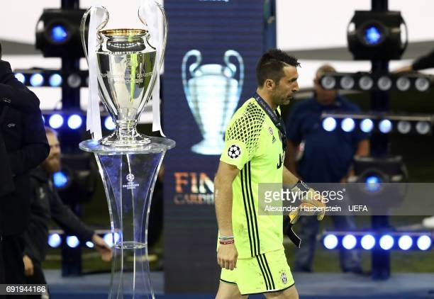 Gianluigi Buffon of Juventus collects his runners up medal after the UEFA Champions League Final between Juventus and Real Madrid at National Stadium...