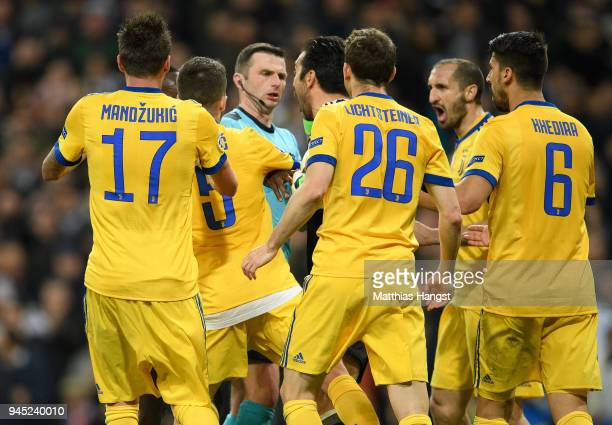 Gianluigi Buffon of Juventus confronts referee Michael Oliver after he awards Real Madrid a penalty during the UEFA Champions League Quarter Final...