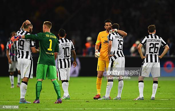 Gianluigi Buffon of Juventus consoles Andrea Barzagli after the UEFA Champions League Final between Juventus and FC Barcelona at Olympiastadion on...
