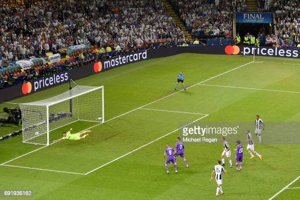 Gianluigi Buffon of Juventus dives but fails to save Casemiro of Real Madrid shot from going in for Real Madrid second goal during the UEFA Champions...