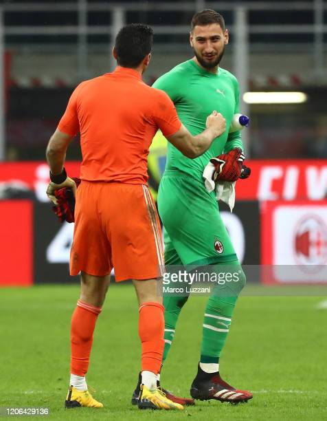Gianluigi Buffon of Juventus embraces Gianluigi Donnarumma of AC Milan at the end of the Coppa Italia Semi Final match between AC Milan and Juventus...