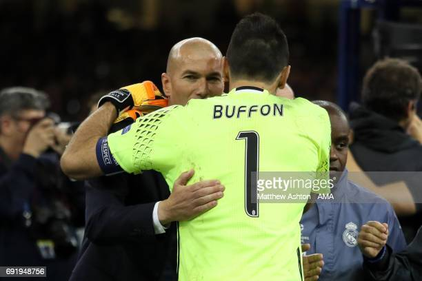 Gianluigi Buffon of Juventus embraces Real Madrid Head Coach / Manager Zinedine Zidane at the end of the UEFA Champions League Final between Juventus...