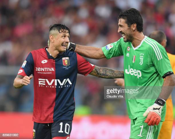 Gianluigi Buffon of Juventus FC and Gianluca Lapadula of Genoa CFC react during the Serie A match between Genoa CFC and Juventus at Stadio Luigi...