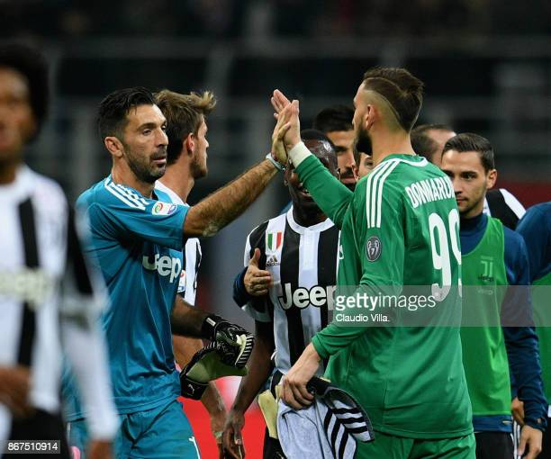 Gianluigi Buffon of Juventus FC and Gianluigi Donnarumma of AC Milan chat at the end of the Serie A match between AC Milan and Juventus at Stadio...